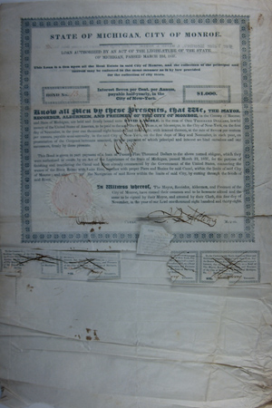 An original $1,000 bond issue for construction of a canal between Lake Erie and the River Raisin in Monroe, Michigan. Michigan Printing.