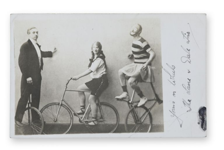 "Real photo postcard of this theatrical cycling troupe, inscribed in autograph ink on the margin of the image, ""Yours on Wheels, The Lane + Dale Trio."" Bicycling, Lane, Dale Trio."