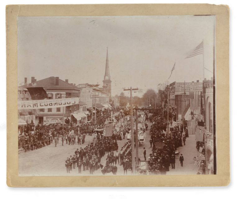 Fine large photographic view of a parade through Bellevue, Ohio, likely for the Columbus Day quadricentennial. Columbus Day in Ohio.