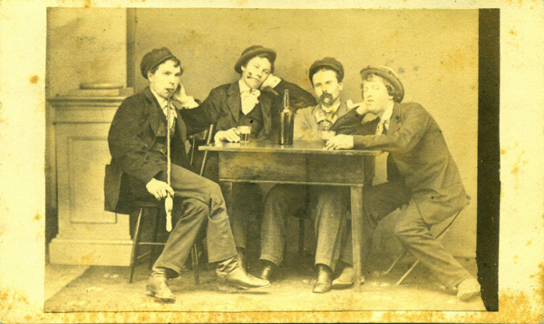 Original studio portrait photograph Carte de Visite (CDV) of four young men posing as though they are smoking pipes and drinking liquor. Photography, Food and Drink.