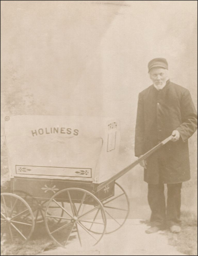 Cabinet card photograph of an as-yet unidentified street evangelist with his Holiness hand-wagon. Holiness, Evangelists.