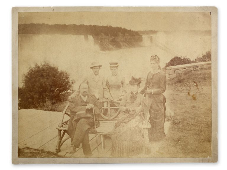 Early portrait of five tourists posed on the Canadian side in front of Niagara Falls. Niagara.