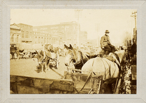 "Original mounted photo with pencil attribution ""Main Street, Rome, Ga. during cotton season.""..."