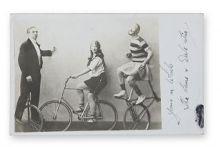 Real photo postcard of this theatrical cycling troupe, inscribed in autograph ink on the margin...