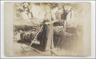 Real photo postcard outdoor portrait of a dignified matron named Mrs. Jones posing with a manual...