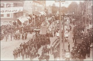 Fine large photographic view of a parade through Bellevue, Ohio, likely for the Columbus Day quadricentennial.
