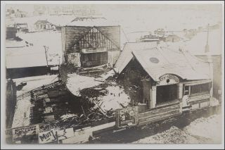 Real photo postcard, and aerial view of the wreckage of the Dewey Theatre in Park City, Utah...