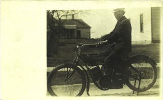 Real photo postcard of a man posed atop a parked early Indian motorcycle. Photography, Indian...
