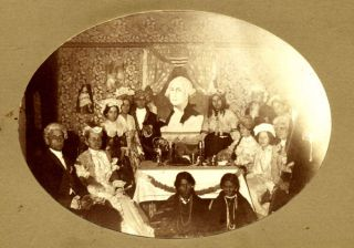 Original mounted photo of a group of people in costume in celebration of Washington's Birthday....