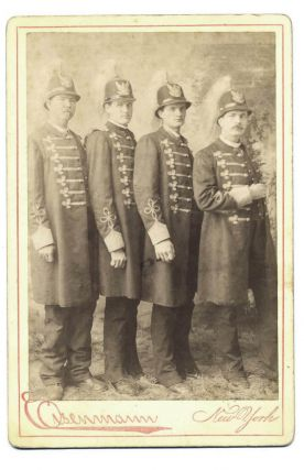 Eisenmann studio cabinet card photo of the Shields Brothers, known as the Texas Giants. Texas Giants.