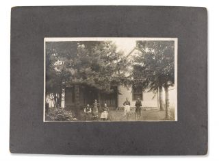 Outdoor portrait of a family in front of house.